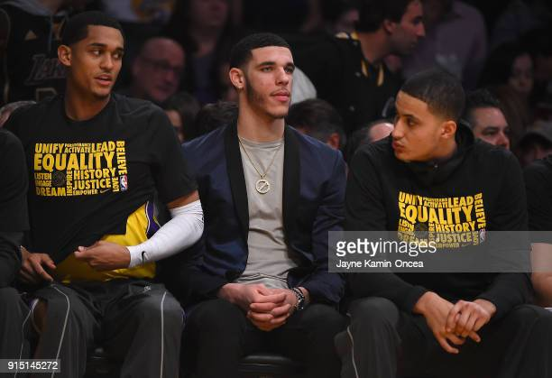 Lonzo Ball sits on the bench inbetween Jordan Clarkson and Kyle Kuzma of the Los Angeles Lakers during the game against the Phoenix Suns at Staples...