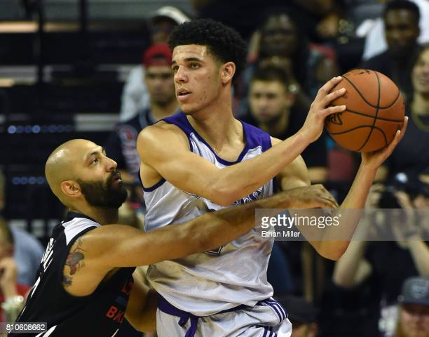 Lonzo Ball the Los Angeles Lakers is guarded by Kendall Marshall of the Los Angeles Clippers during the 2017 Summer League at the Thomas Mack Center...