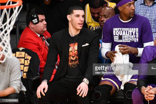 Lonzo Ball watches from the bench during a basketball game between the Los Angeles Lakers and the New Orleans Pelicans at Staples Center on February...