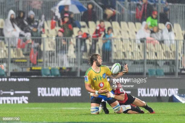 Lood de Jager of the Bulls offloads the ball during the round six Super Rugby match between the Crusaders and the Bulls on March 23 2018 in...