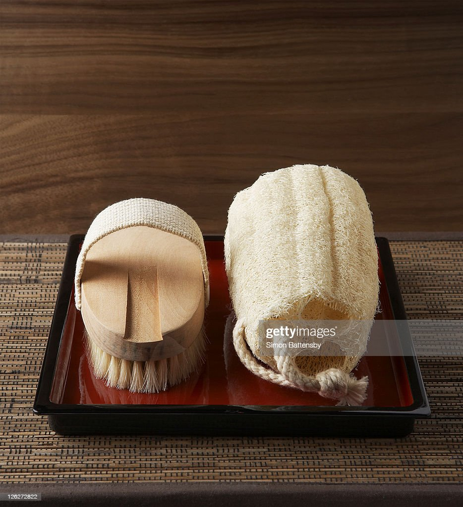 Loofah and brush on tray.3/4 view : Stock Photo