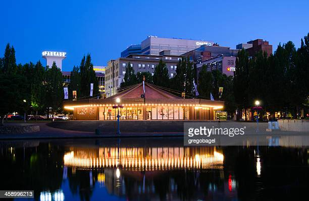 looff carousel along spokane river with downtown in distance - spokane stock pictures, royalty-free photos & images
