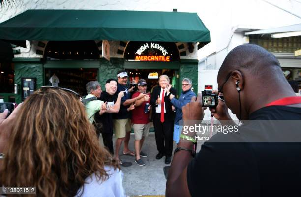 Look alikes for Kim Jong Un and Donald Trump pose with tourists whilst their friends take photos March 22 2019 on Duval Street Key West Florida
