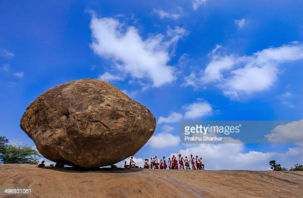 Look at how the rock stands on the hill. The rock stands on less than 4 feet area on the hill. Even a layman knows that a wide base is important for...