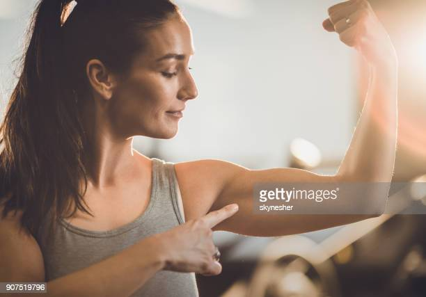 look at my biceps! - flexing muscles stock pictures, royalty-free photos & images