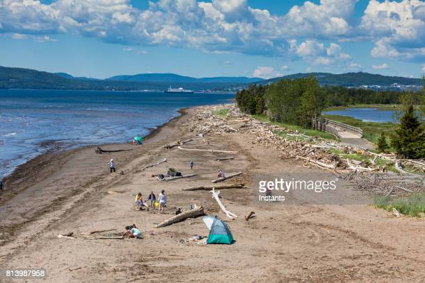 A look at Penouille Beach in Forillon, one of Canada's 42 National parks and park reserves, situated near Gaspé, Eastern Québec. Incidental people are present in the image.