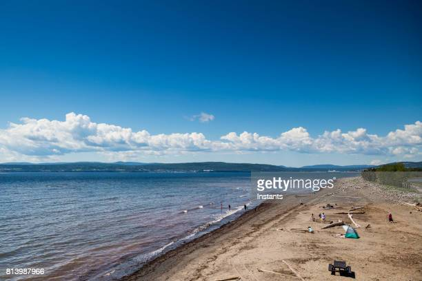 a look at penouille beach in forillon, one of canada's 42 national parks and park reserves, situated near gaspé, eastern québec. incidental people are present in the image. - forillon national park stock pictures, royalty-free photos & images