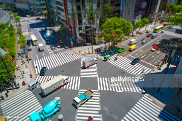 look at the crosswalk of the scrambled intersection from above - overhead view of traffic on city street tokyo japan stock photos and pictures