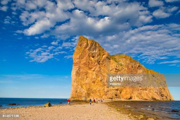A look at the famous Rocher Percé (Percé Rock) in Percé, part of the Gaspé peninsula in the Canadian province of Québec. Incidental people are visible in the image.