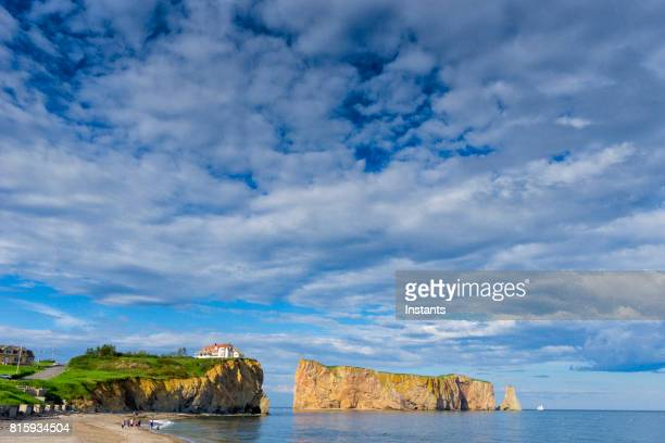 a look at the famous rocher percé (perce rock), part of the gaspé peninsula in the canadian province of québec. - gaspe peninsula stock pictures, royalty-free photos & images