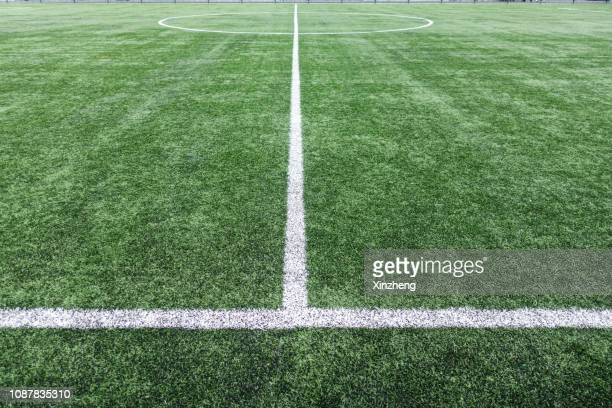 look at the football field through the barbed wire - rugby field stock pictures, royalty-free photos & images