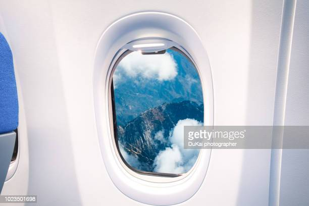 look at the great wall from the window - porthole stock photos and pictures