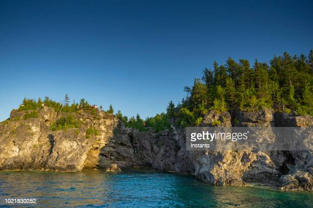 A look at the Grotto, a scenic cave containing a pool of blue water, in Bruce Peninsula National Park which is situated in Southern Ontario.