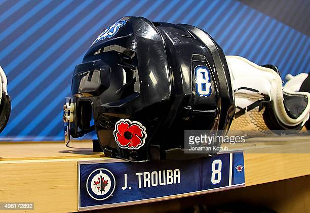 A look at the helmet for Jacob Trouba of the Winnipeg Jets which sports a poppy decal in honor of Remembrance Day prior to NHL action against the...