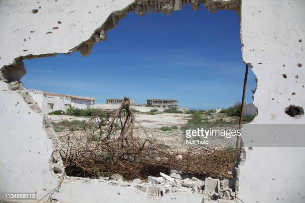 A look at the National Vehicle Registration through a hole in the bullet riddled wall Mogadishu Somalia 15 May 2012