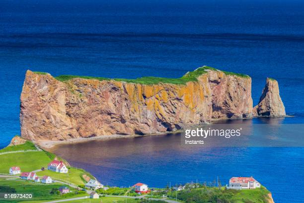 a look at the small town of percé and its famous rocher percé (perce rock), part of gaspe peninsula in québec. - traditionally canadian stock pictures, royalty-free photos & images