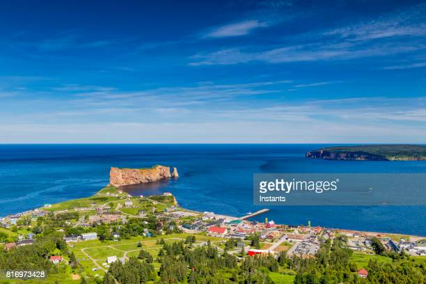 a look at the small town of percé and its famous rocher percé (perce rock), part of gaspe peninsula in québec. - gaspe peninsula stock pictures, royalty-free photos & images