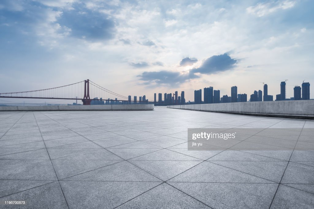 Look at the Wuhan Yangtze River Bridge and the buildings on the other side of the platform. Wuhan City, Hubei Province, China. : Stock Photo
