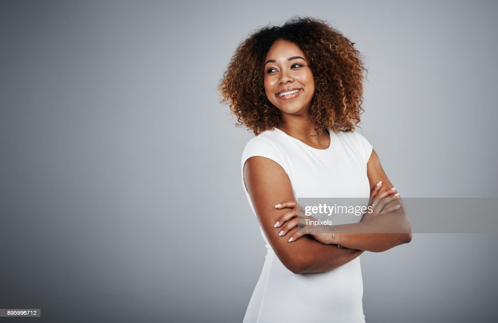 I look back and smile at how far I've come : Stock Photo