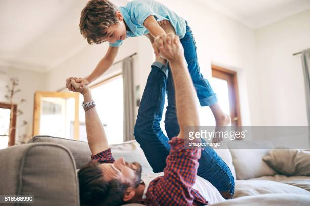 look dad, i'm superboy! - rough housing stock pictures, royalty-free photos & images