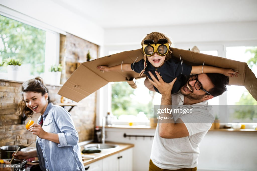 Look daddy, I'm an airplane! : Stock Photo