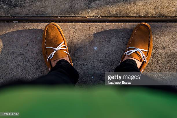 look down to earth and journey around the world , bangkok , thailand. - loafers stock pictures, royalty-free photos & images