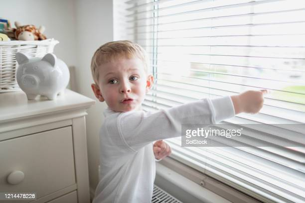 look mam! - one boy only stock pictures, royalty-free photos & images