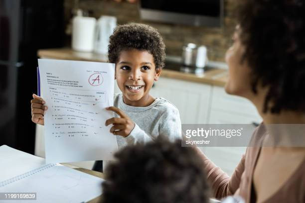 look mommy, i've got an a on my test! - test results stock pictures, royalty-free photos & images