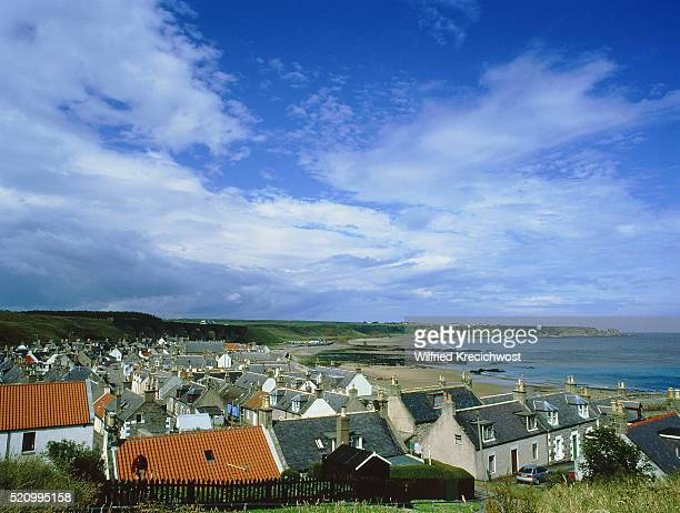Look over sea of houses and coast in Cullen, Scotland, Great Britain