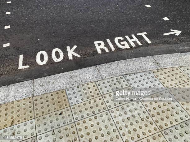 look right and arrow painted on a london street - tar stock pictures, royalty-free photos & images