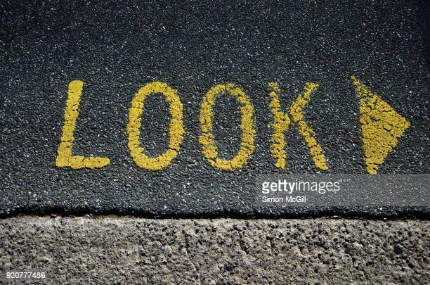 Look right sign painted on a road