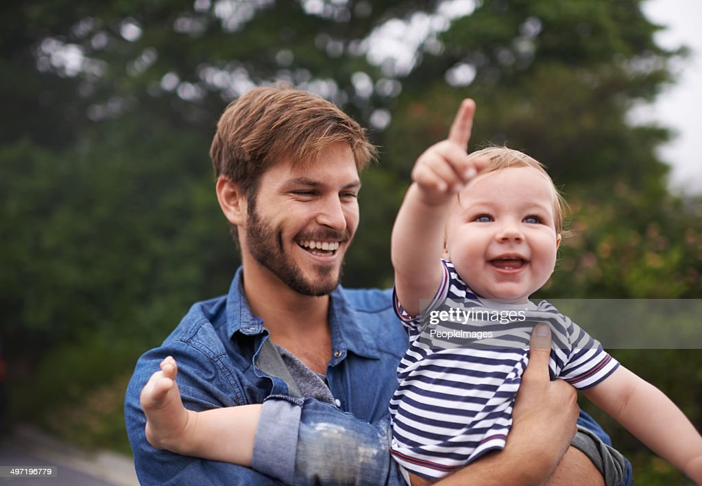 Look up there Daddy! : Stock Photo