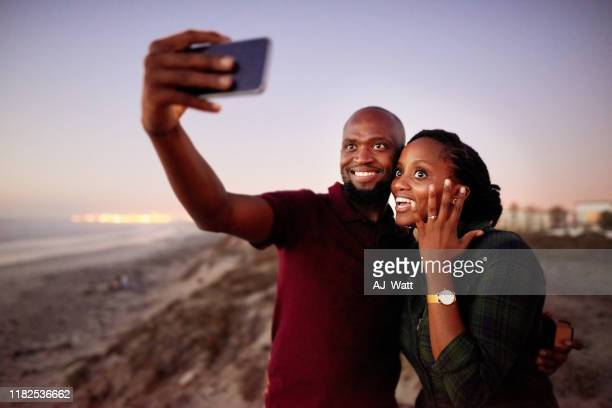 look we just got engaged! - black women engagement rings stock pictures, royalty-free photos & images