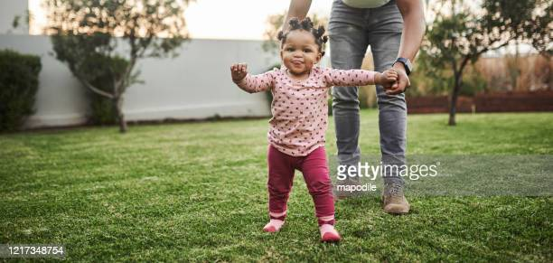 look who's walking! - toddler stock pictures, royalty-free photos & images