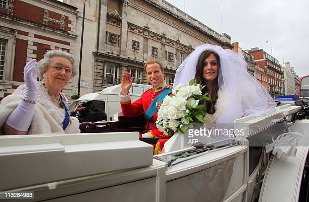 Lookalikes of Britain's Queen Elizabeth II Kate Middleton and Prince William arrive on Piccadilly in central London for the launch of a book entitled...