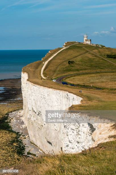 looking across the chalk headland and cliffs of beachy head to belle tout lighthouse on england's so - sussex stock pictures, royalty-free photos & images
