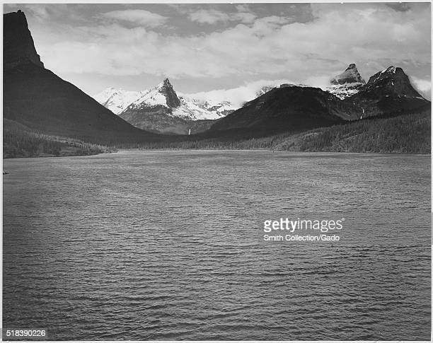Looking across toward snowcapped mountains lake in foreground St Mary's Lake Glacier National Park Montana Ansel Adams Photographs of National Parks...