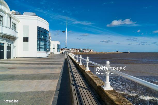 looking along bridligton promenade, past theatre towards harbour, yorkshire, england, uk - bridlington stock pictures, royalty-free photos & images