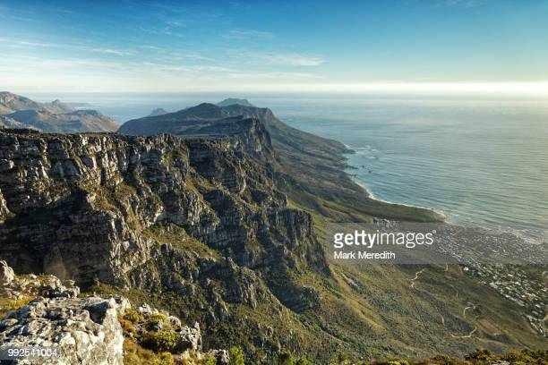 looking along the twelve apostles range and camps bay below, on table mountain, cape town - south africa stock pictures, royalty-free photos & images