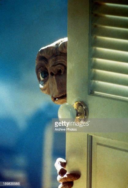 ET looking around door in a scene from the film 'ET The ExtraTerrestrial' 1982