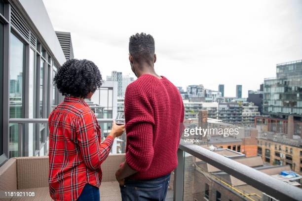 looking at a city view from their new place - architectural feature stock pictures, royalty-free photos & images