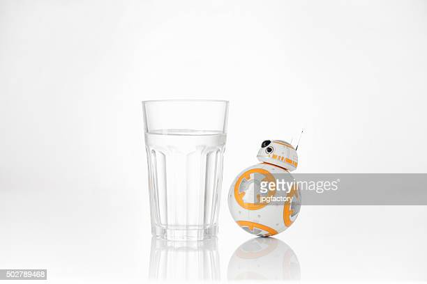 BB-8 looking at a glass of water