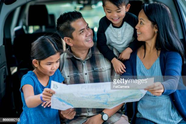 looking at a map - asia map stock pictures, royalty-free photos & images