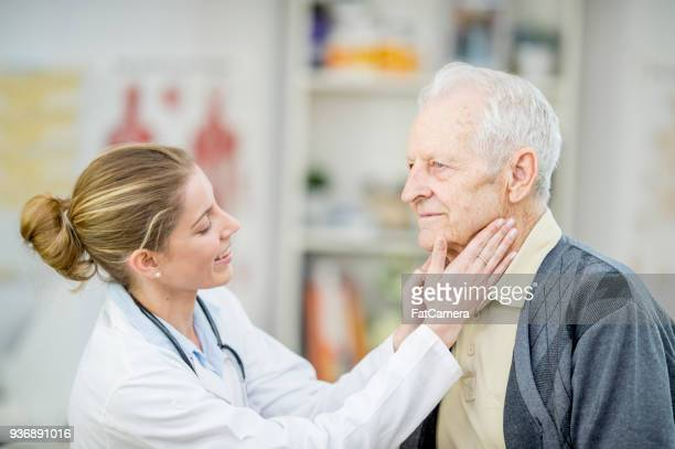 looking at a patient's neck - throat photos stock photos and pictures