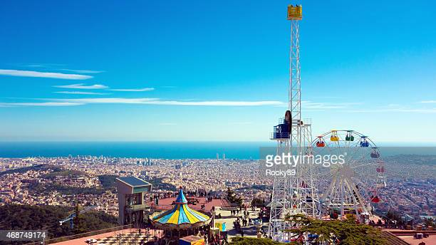 looking at barcelona from mount tibidabo - tibidabo stock pictures, royalty-free photos & images