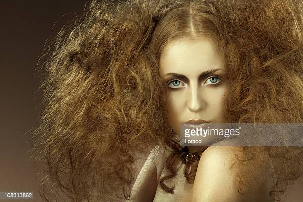looking at camera woman with backcombing - backcombed stock photos and pictures