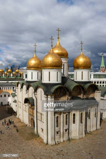 looking at cathedral of the dormition with dark clouds approaching - state kremlin palace stock pictures, royalty-free photos & images