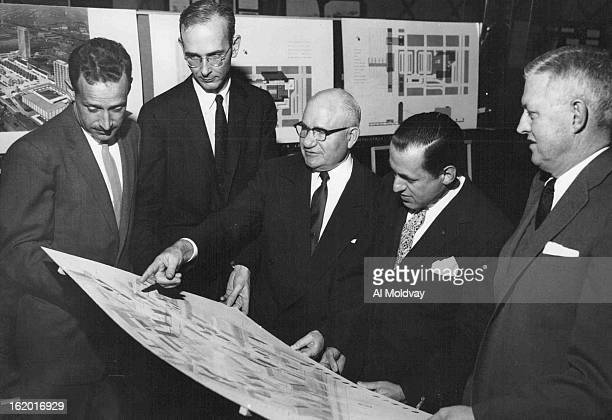 JAN 24 1957 1301957 Looking at civic center expansion proposed for Denver's master plan Friday night at annual meeting of Downtown Denver Improvement...