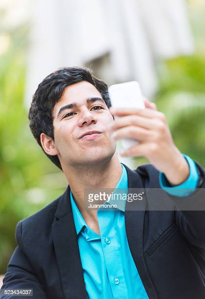 looking at his smart phone - only young men stock pictures, royalty-free photos & images