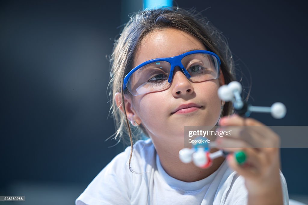 Looking at molecular structure model. : Foto de stock